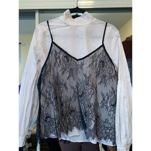 White blouse with black lace over it